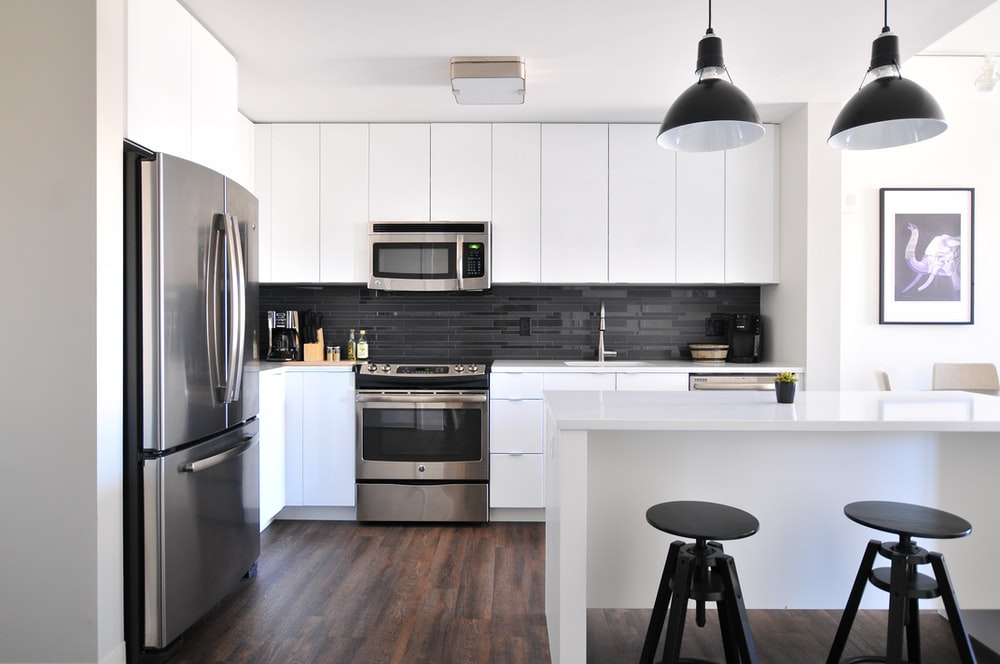 Description: gray steel 3-door refrigerator near modular kitchen