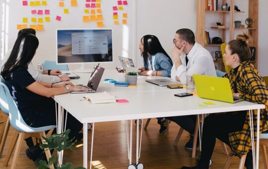 A group of people having a meeting in an office