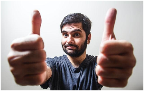 A man showing thumbs up.
